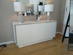 Book sideboard with ceramic frame and white glass fronts. It includes four drawers and two doors. Many different sizes and finishes available.
