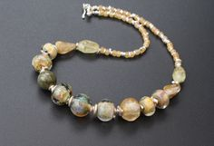 Lampwork beads, rutilated quartz, green aquamarine, silver and Czech beads. One of a kind.