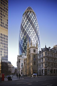 St Mary Axe Church stands proudly in front of the Gherkin, London. -- 25 Pieces Of Old Architecture Meeting New in Perfect Harmony