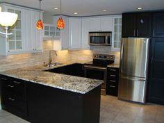 Black-Brown-Kitchen-Cabinets-with-Hanglamp.jpg 800×600 pixels