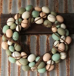 Egg Wreath...you can buy wooden eggs at Hobby Lobby to do this with!