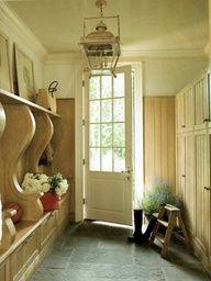 Want bluestone floor like this in our sunroom. Mudroom w/ bluestone floor and Paul Ferrante lantern; Suzanne Kasler design
