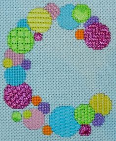 Bubble letter in needlepoint