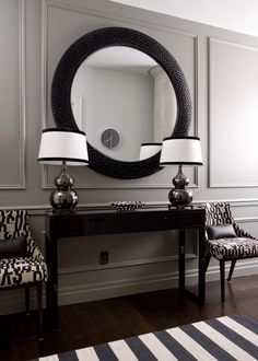 Paint color is Benjamin Moore Chelsea Gray and the trim molding is fabulous. Paint color is Benjamin Moore Chelsea Gray and the trim molding is fabulous. Notice how they made the panel in the middle wider for the mirror. Decor, Foyer Decor, Foyer Decorating, Interior, Entryway Decor, Home Decor, House Interior, Coastal Interiors Design, White Decor