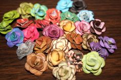 Another great way to use up scraps... rosettes created with a 6-petal punch.  I've made several of these and they're super easy!