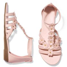 """Full of springtime charm, these leatherlike floral sandals have a zipper back and an adjustable elastic stretch ankle strap for easy on/off. 1"""" H demi-wedge. Half sizes, order one size down."""