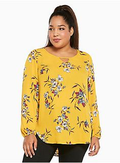 """<p>5 out of 5 stylists agree; this top guarantees you'll be the best-dressed everywhere. The mustard yellow georgette brightens up any look, the floral print is a fuss-free feminine touch, while the keyhole neck is sexy without being scandalous. The curved shirttail hem relaxes the style.</p><BR><p><b>Model is 5'10"""", size 1</b></p>  <ul> <li style=""""LIST-STYLE-POSITION: outside !important; LIST-STYLE-TYPE: disc !important"""">Size 1 measures 31 1/4"""" from shoulder</li> <li style=""""LI..."""