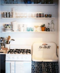 such a cute kitchen — love the open shelves