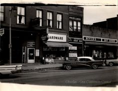 ID#: 0048 Date: 1933-1960s. Watson's Hardware, Minute Lunch at #24 South Main Street and BeViers Dry Goods at #20 South Main Street. Participant:Barbara MolyneauxHistorical Information:Additional Sources: O.H.I.O. Resource Center: Fred Maddock files., Historic Preservation Commission, Survey 1998, City Directories;Internet correspondence from Jim Molyneaux, 01/16/01. Interview with Jim and Barbara Molyneaux, 6/00. Interview with Glenn Molyneaux, 6/00; Interview with Pat Stetson, 01/01 Hardware Stores, New Paltz, Retail Stores, Dry Goods, Main Street, Packaging, Ads, Signs, Lingerie