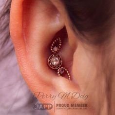 """perrymdoig: """"One of my favorite projects to-date. Triple conch piercing featuring three rose gold stunners from @bvla. The top """"Melody's Tear"""" features a AAA white Opal, the bottom one features a AA amethyst, and the """"Bandera"""" in the center features..."""