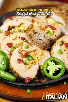 Jalapeno Popper Stuffed Pork Tenderloin #pork #recipes but maybe for us take out seeds and ribs of the pepper!