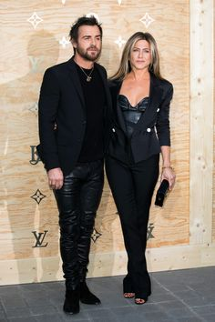 Jennifer Aniston and Justin Theroux Slay in Date Night Leather Looks | The lovebirds wore coordinating head-to-toe black ensembles for the launch of Louis Vuitton's collaboration with artist Jeff Koons at the Louvre in Paris Tuesday night.]