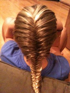 A fishtail French braid. What I do for my little sisters travel soccer games. Stays in good if don tight but still looks cute loose.