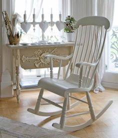 White painted rocking chair ~ Love the candles and hearts in the window.