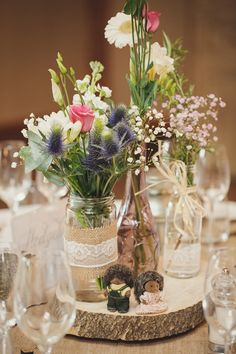 Handmade Woodland Wedding Log Jar Flowers http://www.gemmawilliamsphotography.co.uk/