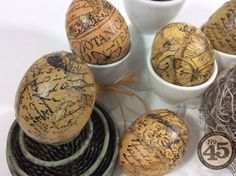 Decoupage eggs with stamped tissue paper.
