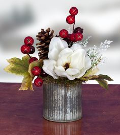 White magnolia and red berry accent piece in cute galvanized tin container. Features - 50% OFF ! - 9 in Tall x 8 in Diameter - Made-to-Order In Powell Ohio - Designer Quality Imported Silk Floral - Pe