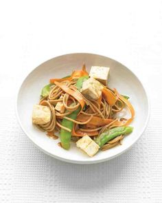 If you're looking for a slightly more authentic flavor to this Asian-inspired dish of tofu, snow peas, carrots, and a potent peanut sauce, consider soba noodles, which are similarly colored and just as nutritious.
