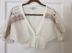 Forever 21 off white cardigan. Size Small. Fitted at waist full on top.  Floral and lace detail on sleeves.  Worn once, excellent condition.  $15 shipped in U.S.