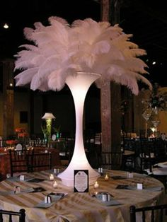 lighted feather vase: party decor for all special events, balloon decor, lighted feather centre pieces, large martini vases, chair cover hire with choice of sash colour, covering