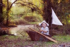 love the set up for this picture...newspaper hat, old wheelbarrow boat, twig fishing pole with a paper fish etc...all you need is a boy with some imagination...more photos of this session on this link...sailor hat instructions at www.dltk-kids.com...
