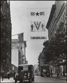 "Victory celebration banner, ""Our Boys - God Bless Them,"" Sullivan St. looking south towards Bleecker St., John Albok"