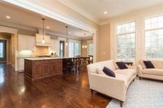 Kitchen, dining room and couches with hardwood floors at 2100 Dorset Road, Ann Arbor, MI, 48104
