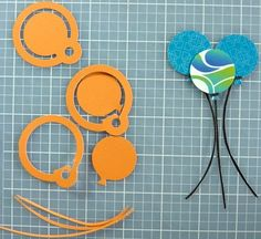 """tep 1: Punch 3 circle tags from slide-in cards.  Step 2: Trim away the outside ring from each tag with scissors, leaving the balloon """"end"""" on the bottom of the circle.  Step 3: Hand trim balloon strings from black cardstock.  Step 4: Adhere pieces together with Tape Runner."""