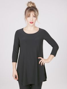 3/4 Sleeve Tunic Simple and sleek tunic with slightly rounded hem. Side vents. Rounded neckline.