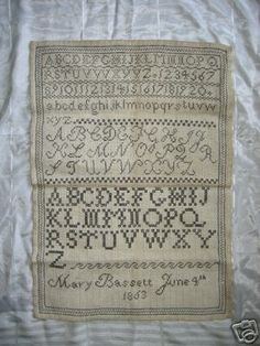 ANTIQUE SAMPLER - Bassett.     I just love a good alphabet...or two...or three :)