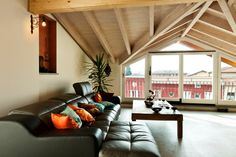 Enormous windows have been installed beneath the eaves of this attic, keeping…