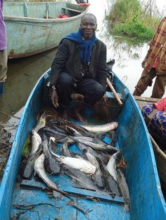 Uganda ~ Fisherman with wild fish