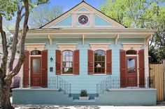 Traditional Exterior of Home with Pathway, Glass panel door, Arched window, Transom window, Gate Traditional Home Exteriors, Traditional House, Craftsman Exterior Colors, Creole Cottage, Shotgun House, Old Houses For Sale, New Orleans Homes, Glass Panel Door, Arched Windows