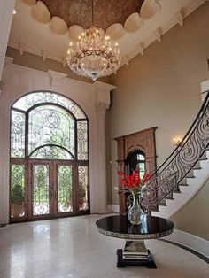 Wrought iron stairs and door.  Beautiful foyer.