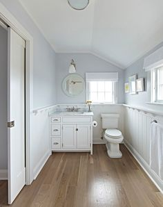 Bathroom Wood Floor and Wainscoting. The master bathroom features wide plank solid white oak hardwood floors. Bathroom Wood Floor and Wainscoting Ideas. Bathroom Wood Floor #Bathroom #WoodFloor #Wainscoting Chango & Co.