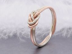 14k solid rose gold love knot ring, double strand nautical engagement ring, thick gauge by TDNCreations on Etsy https://www.etsy.com/listing/239216721/14k-solid-rose-gold-love-knot-ring