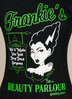 Frankies Beauty Parlor T Shirt:Even ghoul's need some glamour. This 100percent cotton womens black t-shirt features a busty Bride of Frankenstein posing by Frankie's Beauty Parlour in which the sign reads, We'll Make You Look Drop Dead Gorgeous. The text and design is white and green with black details. Turn inside out, machine wash on cold and tumble low to dry. $22.00