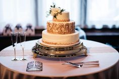Glamorous vintage wedding cake featuring a custom scroll work- iron gate design by the groom, recreated by the pastry chef at CJ's Off the Square, Franklin, TN