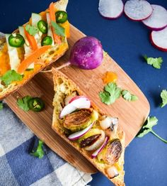 Brussels Sprout Banh Mi with Spicy Mango Sauce | yupitsvegan.com. Vegan banh mi sandwiches stuffed with crispy roasted Brussels sprouts, a simple mango sriracha sauce, and tons of fresh veggies.