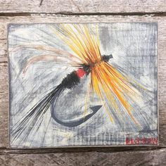 Day 174: A fly fishing fly. Acrylic on wood.