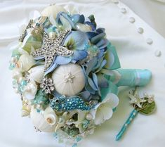 A gorgeous beach wedding bouquet design in blue and white. #wedding #bouquet #beach