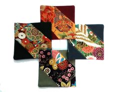 A set of 4 coasters made of colorful Japanese kimono fabric. Size: 11cm x 11cm.