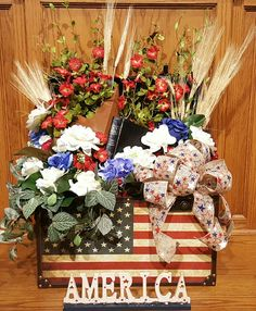 July 4th arrangement. BIBLE AND metal star in flag painted trunk with wheat