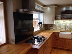 Image result for kitchen wood cabinets and wood worktop