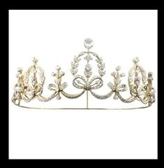 A delicate diamond tiara necklace, circa 1890. Featuring three ribbon and wreath garland panels, interlinked by four ribbon and flower spacers. Bentley and Skinner