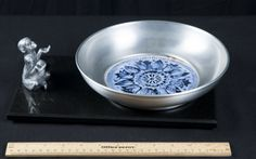 METAL SERVING TRAY WITH MONKEY 12 IN. LONG - METAL BOWL WITH BLUE AND WHITE TILE IN THE MIDDLE BY BUENILUM MADE IN USA 9 IN. DIAMETER