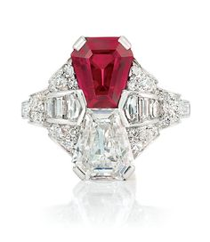 Art Deco Platinum, Ruby and Diamond Ring   Set with one shield step-cut ruby…