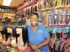 Pin It. MONEY—Nora Johnson, of Sisters Beauty Supply, poses with hair pieces ...