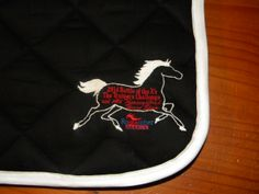 Close up of the 2014 Battle of the Xs, #OTTB Trainer's Challenge logo immortalized on our saddle pad!