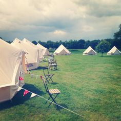 Bell tent village set up for a camp ground wedding at York Maze, Yorkshire. #glamping